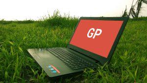 Laptop on Grass Mockup PSD